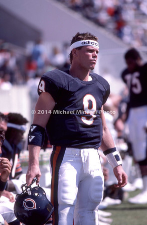 TAMPA, FL - OCTOBER 6: QB Jim McMahon #9 of the Chicago Bears stands near the bench ready to go back in the NFL game against the Tampa Bay Buccaneers at Tampa Stadium on October 6, 1985 in Tampa, Florida. The Bears defeated Tampa Bay 27 to 19. (Photo by Michael J. Minardi) *** Local Caption *** Jim McMahon