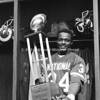 "TAMPA, FL - JANUARY 1978; Running Back Walter Payton #34 of the Chicago Bears wins ""Mover of the Year"" for a rushing record of 1852 yards for the 1977 NFL season. A trophy was presented to him in Tampa, Florida after the National League All Star Game in Tampa Stadium. (Photo by Michael Minardi)***Local Caption*** Walter Payton"