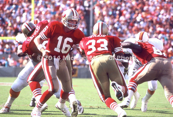 TAMPA, FL - SEPTEMBER 17; QB Joe Montana #16 hands off to Full Back Roger Craig #33 both of the San Francisco 49ERS against the Tampa Bay Buccaneers at Tampa Stadium on September 17, 1989 in Tampa, Florida. The 49ERS won 20-16. (Photo by Michael Minardi) *** Local Caption *** Joe Montana;Roger Craig