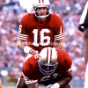 TAMPA, FL - SEPTEMBER 17; QB Joe Montana #16 steps up to the offensive line behind his Center Jesse Sapolu #61 both of the San Francisco 49ERs against the Tampa Bay Buccaneers on September 17, 1989 at Tampa Stadium in Tampa, Florida. The 49ERs won 20-16. (Photo by Michael Minardi) *** Local Caption *** Joe Montana;Jesse Sapolu