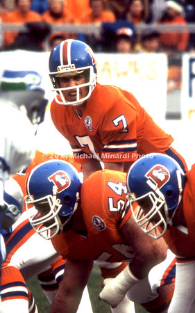 DENVER, CO - NOVEMBER 25: QB John Elway #7 of the Denver Broncos calls the signals in his first NFL game against the Seattle Seahawks at Denver Mile-high stadium because of an injury to the first string Quarterback of the Denver Broncos. The Seahawks defeat Denver 27 to 24. (Photo by Michael J. Minardi) *** Local Caption *** John Elway
