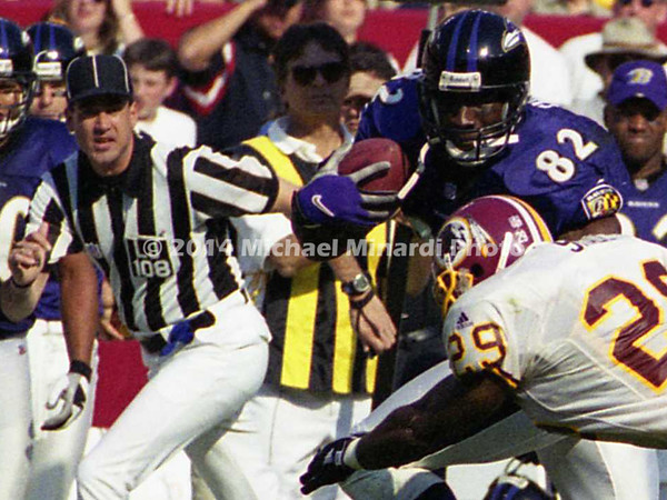 LANDOVER, MD - OCTOBER 15: Tight End Shannon Sharpe #82 of the Baltimore Ravens runs along the sideline in front of Line Judge Gary Arthur #108 avoiding being tackled by Safety Sam Shade #29 of the Washington Redskins and carries the ball for some extra yardage in a NFL game at FedEx Field on October 15, 2000 in Landover, Maryland. The Redskins won 10-3 against the Ravens. (Photo by Michael J. Minardi)