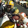 TAMPA, FL - DECEMBER 24: Running Back Reggie Cobb #32 of the Green Bay Packers carries the ball for some extra yardage when Defensive Back Marty Carter #23 of the Tampa Bay Buccaneers tries to tackle him during a NFL game at Tampa Stadium on December 24, 1994 in Tampa, Florida. Green Bay won the game 34-19. (Photo by Michael J. Minardi) *** Local caption *** Reggie Cobb;Marty Carter
