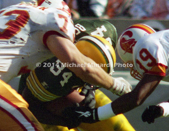 TAMPA, FL - DECEMBER 24: Running Back Edgar Bennett #34 of the Green Bay Packers carries the ball for some extra yardage against the Tampa Bay Buccaneers when he runs into Defensive Tackle Brad Culpepper #73 and Defensive Back Charles Dimry #39 who tackle him during a NFL game at Tampa Stadium on December 24, 1994 in Tampa, Florida. Green Bay won the game 34-19. (Photo by Michael J. Minardi) *** Local caption *** Edgar Bennett
