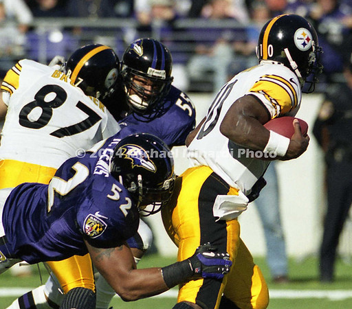 BALTIMORE, MD -OCTOBER 29: Quarterback Kordell Stewart #10 of the Pittsburgh Steelers is tackled by Linebacker Ray Lewis #52 of the Baltimore Ravens during a NFL game at PSINet Stadium on October 29, 2000 in Baltimore, Maryland. The Steelers won the game 9-6. (Photo by Michael J. Minardi) *** Local Caption *** Kordell Stewart;Ray Lewis