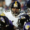 BALTIMORE, MD - OCTOBER 29: Center Dermontti Dawson #63 of the Pittsburgh Steelers and teammate Offensive Guard Alan Faneca #66 try to block Defensive Tackle Sam Adams #95 of the Baltimore Ravens so that the ball carrier Quarterback Kordell Stewart of the Steelers can get some extra yardage in front of Umpire Bill Schuster #129 during a NFL game at PSINet Stadium on October 29, 2000 in Baltimore, Maryland. The Steelers won 9-6. (Photo by Michael J. Minardi) *** Local Caption *** Dermontti Dawson;Alan Faneca;Kordell Stewart;Sam Adams;Bill Schuster