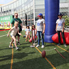 "A young fan set herself up to kick at the ""NFL Rush Zone Field Goal Kick"" game"