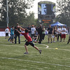 Kordell Stewart passes to a young player at the kids flag football clinic