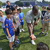 Kordell Stewart chats with young players during the kids flag football clinic