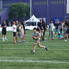 Young fan tries to evade the defender during the kids flag football clinic