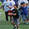 Young player catches a pass during the kids flag football clinic