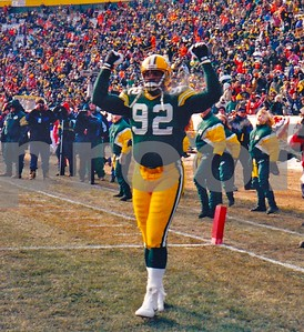 Green Bay Packers Hall of Fame DE Reggie White pumps up the Lambeau crowd before the 1996 NFC CHAMPIONSHIP GAME, won by Packers over Panthers.