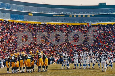 Brett Favre huddles up the Packers during the 1996 NFC Championship Game won by the Packers over the Carolina Panthers in -23 degree bitter cold on the frozen tundra of Lambeau Field.  If you look closely you will see a Panthers lineman's face obstructed by his breadth.