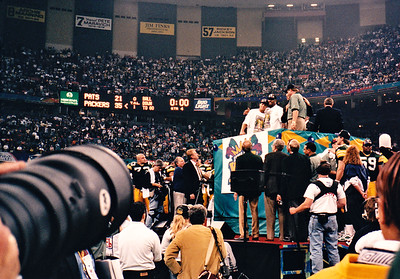 Packers Super Bowl XXXI post game celebration.  Reggie White and Brett Favre on victory podium with Mike Holmgren.