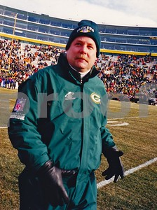MIke Holmgren, Packers head coach walks onto Lambeau Field before the 1996 NFC CHAMPIONSHIP GAME won by the Packers over the Panthers.  This was the first Championship playoff game in Lambeau since the Ice Bowl of 1967.