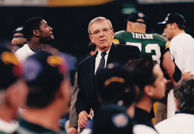 The Architect of the resurgence of the Green Bay Packers, GM Ron Wolf, post Super Bowl XXXI on field standing next to Packers RB Edgar Bennett.