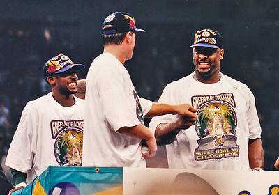 Three great and happy Packers celebrate Super Bowl XXXI Victory:  Game MVP Desmond Howard, Brett Favre and Reggie White.