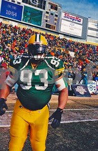 "Gilbert Brown, ""The Grave Digger"", Packers DT walks onto Lambeau Field to warm up for the 1996 NFC CHAMPIONSHIP GAME"