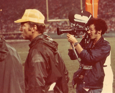 Chuck filming Packers game in Milwaukee for NFL Films in 1974, alongside The Great Bart Starr, Packers Head Coach.  This was the first season Chuck worked for FILMS.  The camera is his Arriflex M with an Angeniuex 12-120mm lens, shooting 48-96fps.