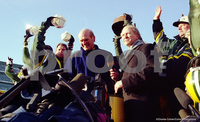 1996 NFC CHAMPIONS! Brett Favre, Terry Bradshaw, Bob Harlan, Mike Holmgren, as the Packers receive the NFC Championship Trophy on a podium on Lambeau Field's Frozen Tundra.