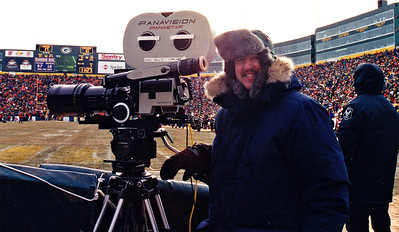 Chuck Cohen at the 1996 (played in Jan '97) NFC Championship Game in Lambeau Field, end zone/on the field camera position, for NFL Films.  The temperture on the field was -23 degrees below zero!  He's shooting with the Panavision Panastar high speed camera and Panavision Primo 135-425mm lens with 2X extender.