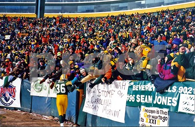 Green Bay Packer safety LeRoy Butler is cheered on by Packer fans during pre-game of 1996 NFC Championship Game in Lambeau Field.