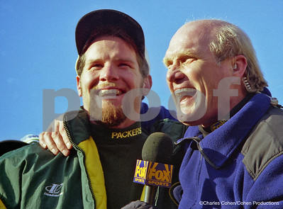 MVP Brett Favre and Terry Bradshaw share a laugh during the post game ceremony in Lambeau Field after the Packers beat the Panthers for the 1996 NFC Championship Title and a trip to the Super Bowl in New Orleans.