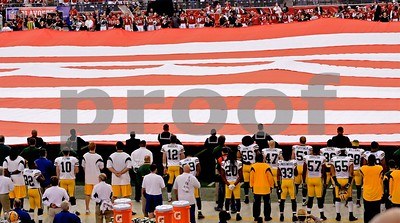 Star Spangled Banner is sung as both teams face the flag
