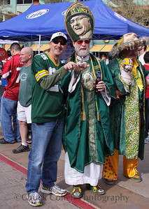 St. Vince shows off his Lombardi Super Bowl Trophy ring and a Packers fan shows off his knuckle