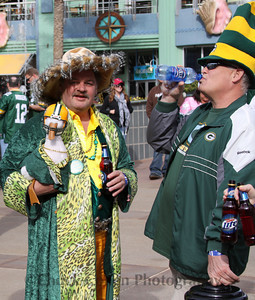 "That's Matt Millen hiding from Lions fans dressed in Packers drag holding the afflack duck and a cold one as his buddy downs a cold ""water""!"