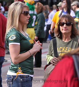 Lovely Packer fans figuring out their next move at the pre game tail gate party