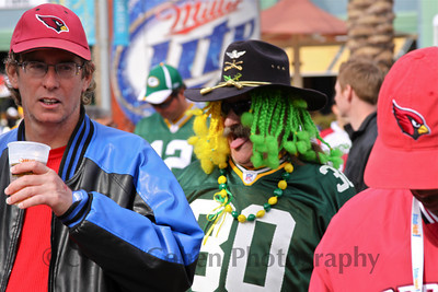 Packers fan shows his team spirit...or maybe, just wants another sip of beer...while Cardinals fans are happy to ignore him