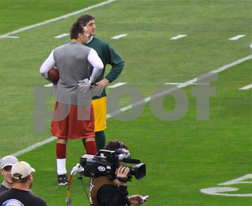 Quarterbacks Kurt Warner of the Cardinals and Aaron Rodgers of the Packers during pre-game warmups