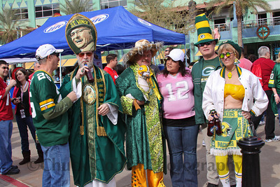 St. Vince is getting tired of getting an ear full from a Packers fan, wants more Miller Lite, while his buddys wait for him to pose for a picture