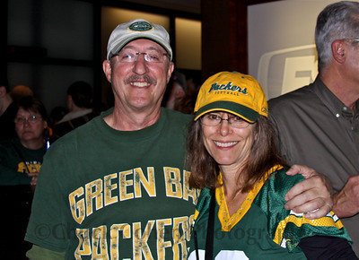 A Packer couple shows their Packers Pride