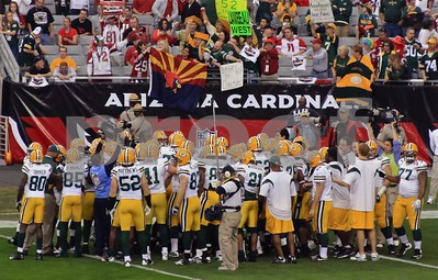 The Green Bay Packers team huddles up before kickoff