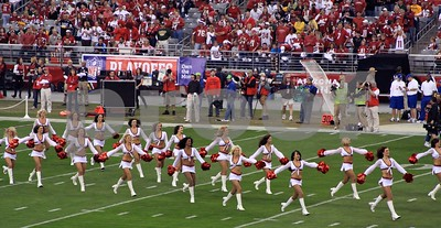 Happy Cardinals cheerleaders prance onto field