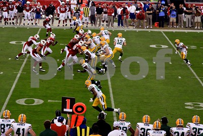 Packers linemen take on charging Cardinals players as Aaron Rodgers drops back to pass during what some have called the greatest playoff game ever...