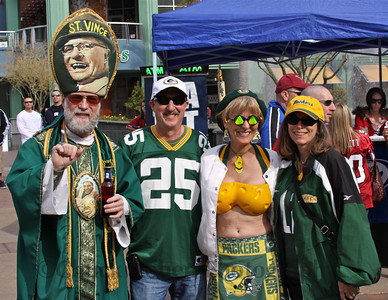 "St. Vince and his Packers CheeseBra lady with the cool ""wedge of swiss"" shades and outstanding Cheesehead ensemble pose with their new friends, prior to the wild-card game, Jan., 10, 2010"
