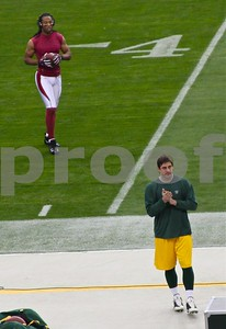 The two best players in the NFL about to meet: Arizona Cardinals All Pro receiver Larry Fitzgerald walks towards Green Bay Packers quarterback and Super Bowl MVP Aaron Rodgers during pre-game warmups