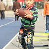 NFL Home Field Beijing - Week 8 - A young visitor tries out some hurdle drills in the Nike Pro Training area