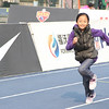 NFL Home Field Beijing - Week 8 - A young visitor runs the 40-yard dash as part of the Nike Pro Training competition