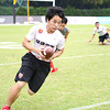 NFL Home Field Guangzhou - Week 9 - Flag football player from Guangdong Vocational College of Environmental Protection Engineering runs the ball during semi-finals of City Championships
