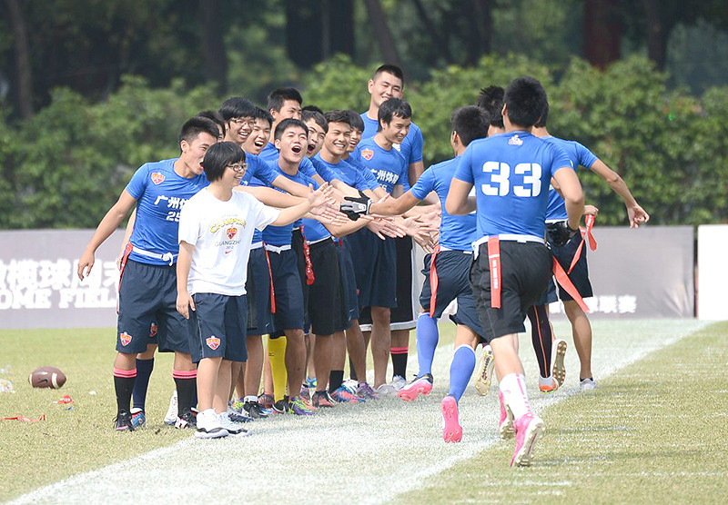NFL Home Field Guangzhou - Week 9 - Guangzhou Sports University flag players are congratulated by teammates as they come off the field after a great play