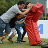 NFL Home Field Guangzhou - Week 9 - Teamwork in action: A family tries out the Defensive Lineman (DL) Challenge at NFL Home Field