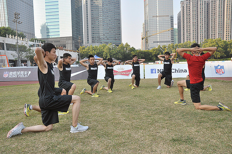 NFL Home Field Guangzhou - Week 8 - Athletes warm up with NPT20 in the Nike Pro Training area
