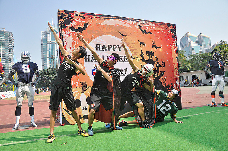 NFL Home Field Guangzhou - Week 8 - Flag football players from the Guangdong University of Technology, Huali College, strike a Halloween football pose