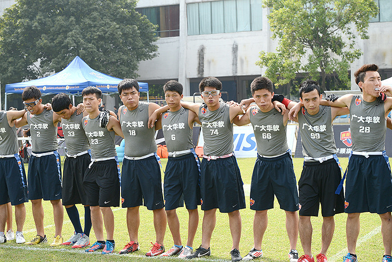 NFL Home Field Guangzhou - Week 9 - Flag football players from Guangzhou University of Software Engineering stand together before their game