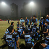 NFL Home Field Shanghai - Week 9 - Players from the China Sea Dragons Senior team huddle up post-game