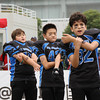 NFL Home Field Shanghai - Week 9 - Youth players from the China Sea Dragons Junior Team stretch before taking the field